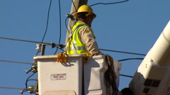 OG&E Linemen Crew Fixing Power Lines Medium Shot Stock Footage