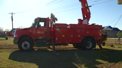OG&E Linemen Crew Fixing Power Lines Tilt Up From Truck to Worker Stock Footage