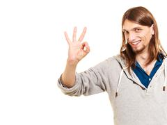 Man showing ok fine alright gesture. Stock Photos
