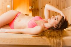 Portrait of woman relaxing in sauna. Spa wellbeing - stock photo