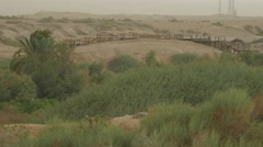 Landscape in Cloudy Windy Day Wooden Bridge Through River Steppe Field Hills Stock Footage