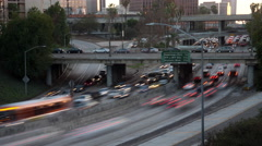 4K time lapse of rush hour traffic on the 110 Freeway in Los Angeles at sunset Stock Footage