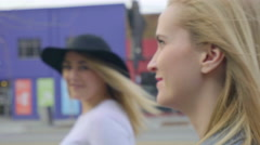 Closeup Of Young Woman's Face As She Walks Down Sidewalk, With Her Friend Stock Footage