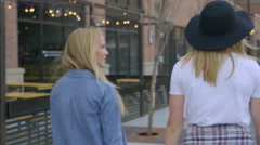Young Women Explore Upscale City Neighborhood Together Stock Footage