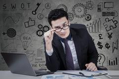 Businessman seeing on the camera Stock Photos