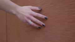 Closeup Of Woman's Hand (With Painted Nails) Touching A Wall As She Walks Past Stock Footage