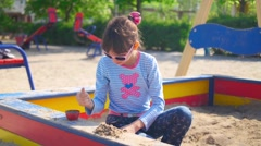 boy and girl playing in the sandbox  - stock footage