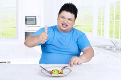 Overweight person with salad and OK sign Stock Photos
