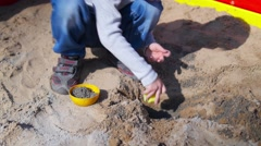 boy playing in the sandbox - stock footage