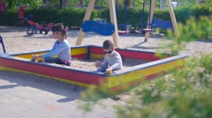 Children play in the sand on the Playground Stock Footage