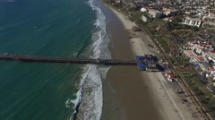 Aerial push into the San Clemente State Beach Pier - stock footage