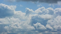 Cumulus clouds move against the blue sky. - stock footage