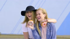 Friends Play With Their Donuts, Make Funny Faces Stock Footage