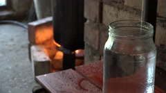 Illegal alcohol production equipment on fire and natural vodka product. 4K Stock Footage