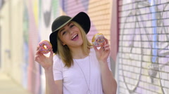 Cute Teen Holds Up Donuts In Front Of Her Eyes, She Makes Different Poses Stock Footage