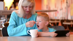 Mother with the son in cafe Stock Footage