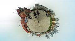 People at Red Blocked Building Clock vr Video 360 Little Planet Video Walkers Stock Footage
