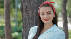 Young american woman pose to photographer outdoor Stock Footage
