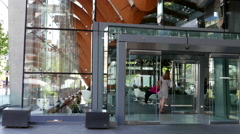 Entrance of modern Telus building at downtown Vancouver - stock footage