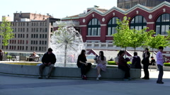 People resting beside fountain water in downtown Vancouver BC Canada. - stock footage