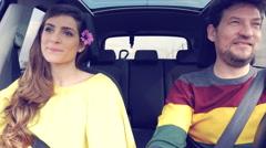 Happy beautiful woman talking with boyfriend in car with flower in hair 4K Stock Footage