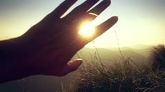 Looking to the Sun through Fingers Stock Footage