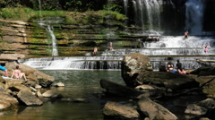 People Enjoy Cummins Falls Waterfall in Tennessee Telephoto Stock Footage