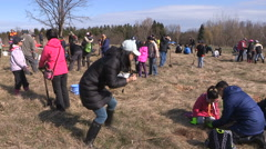 Students plant trees on Earth Day in Markham Canada v2 Stock Footage