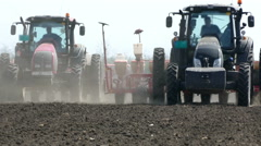 Tractors and Seeder Planting Crops on a Field Stock Footage