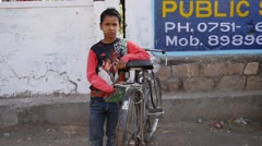 Indian boy with bicycle - stock footage