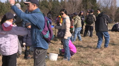 Students plant trees on Earth Day in Markham Canada v3 Stock Footage