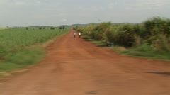 Car shot of Ugandan countryside with roads and fields Stock Footage