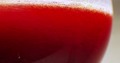 Red wine poured into glass. Close-up, macro shot. Stock Footage