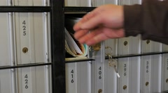 Removing Mail From A Post Office Box - stock footage