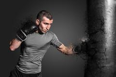 Boxer punching bag blow to the explosion Stock Photos