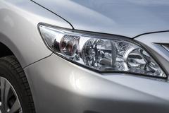 Closeup headlights . Modern  car.  Concept of expensive auto - stock photo