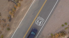 AERIAL: Cars driving on along the historic Route 66 in USA, people traveling Stock Footage
