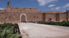 Large group of tourists enter El Badi Palace Marrakesh v1 Stock Footage