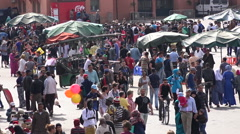 Overhead view of crowds passing through Jemaa El Fnaa in Marrakesh Morocco Stock Footage