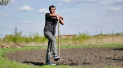 farmer weary man digs ground old dirty shovel on dry video ground slow motion - stock footage