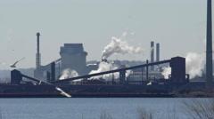 Establishing shot of Steel Mill factories. Blast furnaces. 4K UHD. Stock Footage