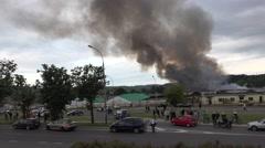 Dense fire smoke from old storage near street. 4K Stock Footage