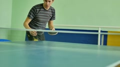 Man feed serve playing athlete table tennis slow motion sport video Stock Footage