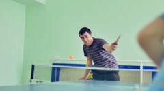 man playing table tennis slow motion video sport backhand - stock footage