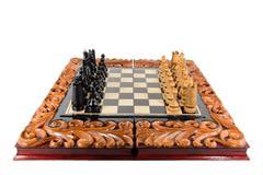 Wooden chessboard handmade on white Stock Photos