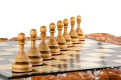 wooden chessboard handmade on white - stock photo