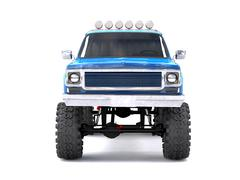 A large blue pickup truck off-road. Full off-road training. Highly raised sus - stock illustration