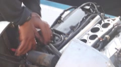 An aircraft mechanic works on an engine. Stock Footage