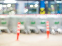 Blurred shopping carts on a parking lot - stock photo