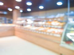 Blur bakery shop with bokeh as background Stock Photos